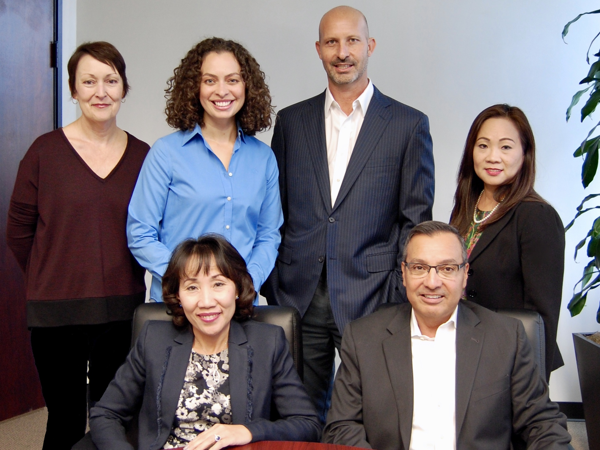 Left to right, bottom row: Katherine Le, CEO; Richard Marron, President; Karen O'Donovan, SVP Project Management Office; Jessica Maraboto, Director of Human Resources; Anthony Minero, SVP Finance & Analytics; Jennifer Vo, VP Corporate Finance/Controller